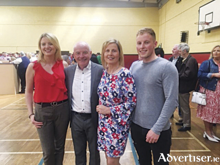 Athlone electoral area poll topper, Cllr. Frankie Keena, is pictured with his wife Siobhan and children, Alanna and Adam, following his re-election in Moate Community Hall on Sunday afternoon