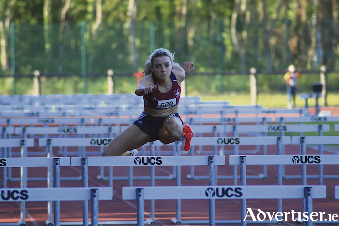Sarah Quinn of NUI Galway on her way to clocking a European U23 qualifying time over 100m hurdles. 			Photo: Leonardo Brule