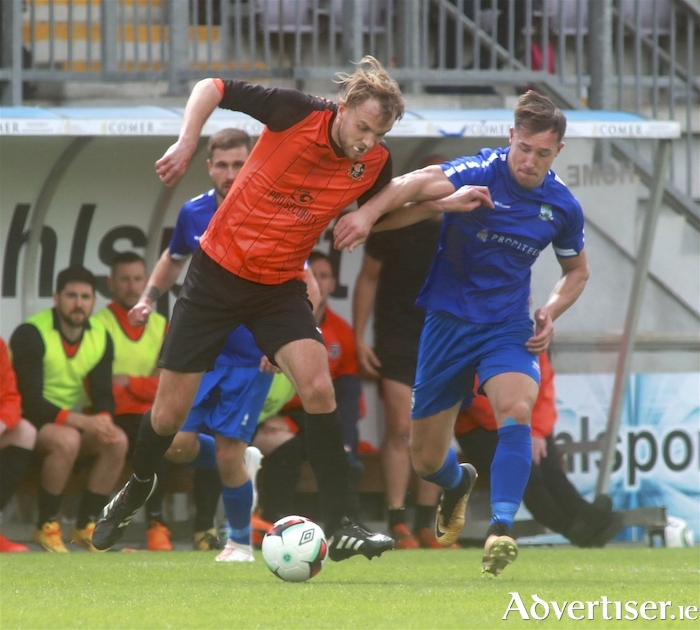 Stephen Gilmore of Corrib Rangers and Manulla FC's Chris Maughan in action from the TP Brennan Cup final at Eamonn Decay Park, Sunday. 