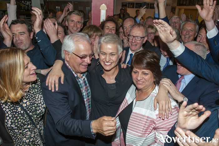 Fine Gael's Maria Walsh celebrates with her parents after being elected a member of the European Parliament. Photo: Michael McLaughlin