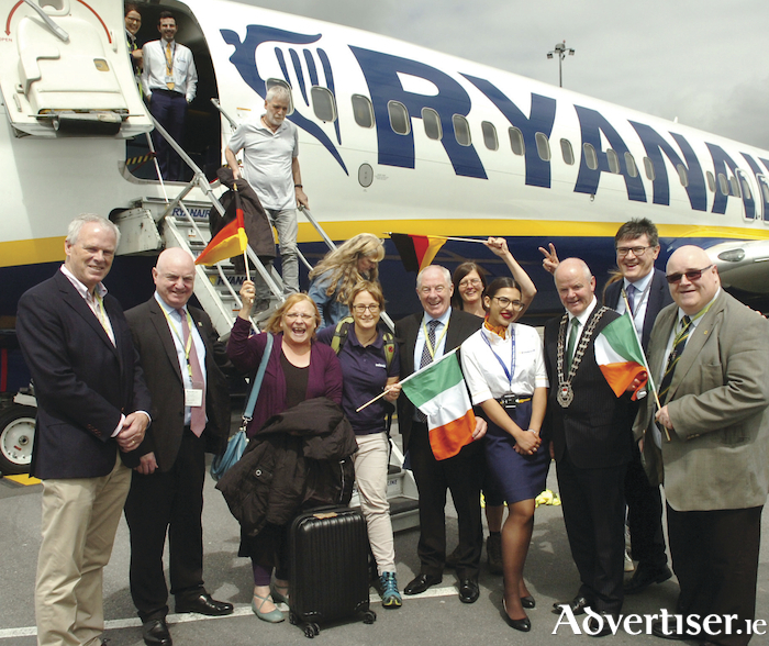 Passengers show their delight following the inaugural Ryanair flight from Cologne to Ireland West Airport Knock. Greeting the passengers on their arrival were Minister for Community Development Michael Ring TD, Mayo Co Council Cathaoirleach Collr Blackie Gavin, Sligo Co Council CEO Ciar?n Hayes, Mayo Co Council CEO, Peter Hynes, Airport Manager Joe Gilmore and Donegal Head of Tourism Barney McLaughlin. Picture Henry Wills.