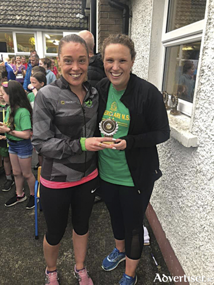 Deirdre Keena (l), from Moate Athlone Running Group finished second female in the Tubberclare NS five mile race.  She was pictured receiving her award from Laura Dermody
