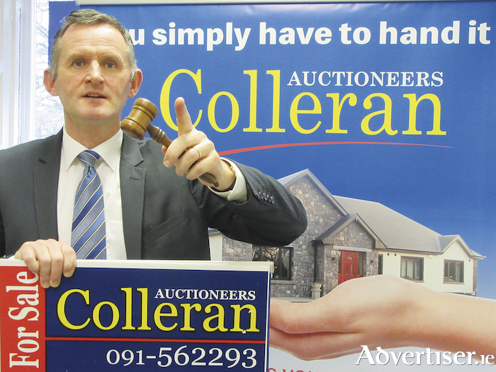 Auctioneer Don Colleran.