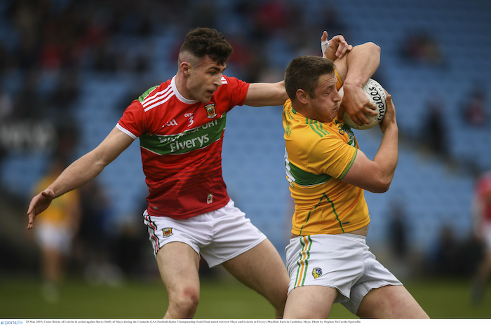 Man and ball: Mayo's Barry Duffy tackles Conor Beirne from Leitrim in the Connacht Junior Football Championship semi-final. Photo: Sportsfile.