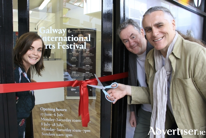 Sarah Callaghan Box Office manager with GIAF's John Crumlish  and Paul Fahy  at the official opening of the Galway International Arts Festival box office in the Cornstore, Monday. Photo:- Mike Shaughnessy