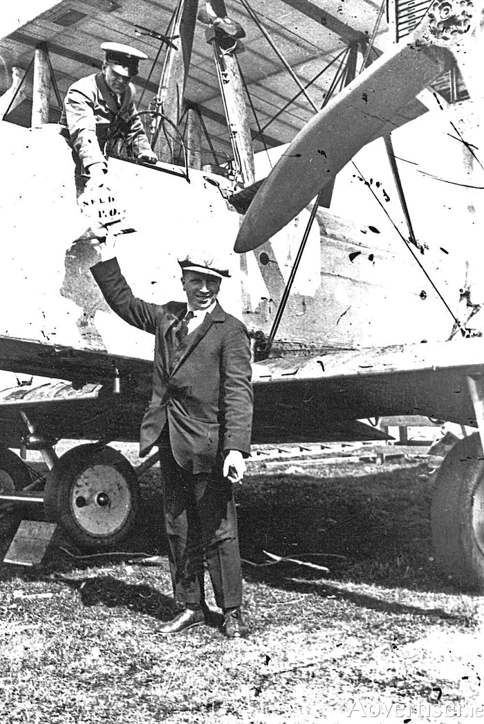Arthur W Brown passes the first mail bag to cross the Atlantic to pilot John Alcock just before their historic flight in June 1919. Alcock's letter to Elsie was included.