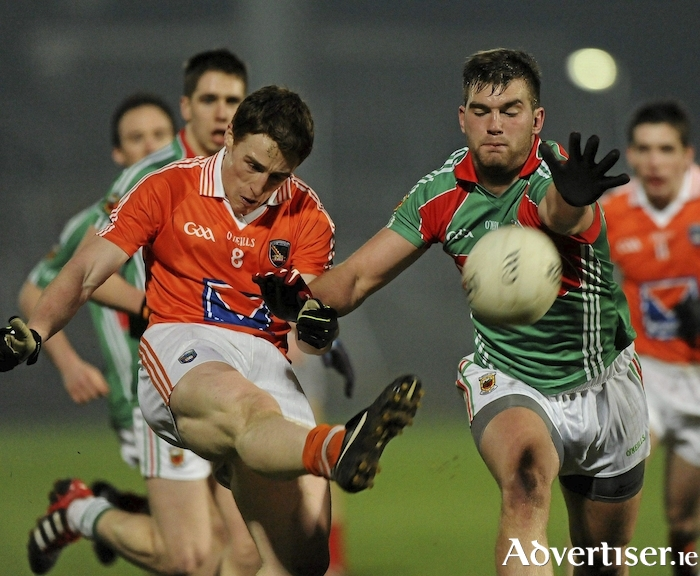 Aidan O'Shea looks to block down Charlie Vernon's shot during Mayo's clash with Armagh in the National Football League back in 2012. Photo: Sportsfile