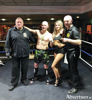 Referee Tony O Donnell, Dara 'The Westside Warrior' Mannion from Black Dragon Kickboxing Gym, Galway, ring girl Ally Carrick, and Black Dragon coach Pete Foley.