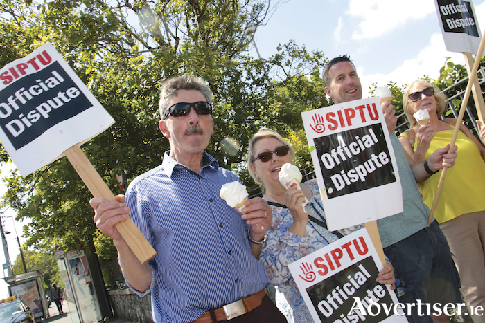 Hospital porter Tom Devaney with health care assistants Kim O'Sullivan, Paul O'Connell, and Mairead O'Sullivan protesting outside University College Hospital, yesterday Wednesday.  Photo:-Mike Shaughnessy