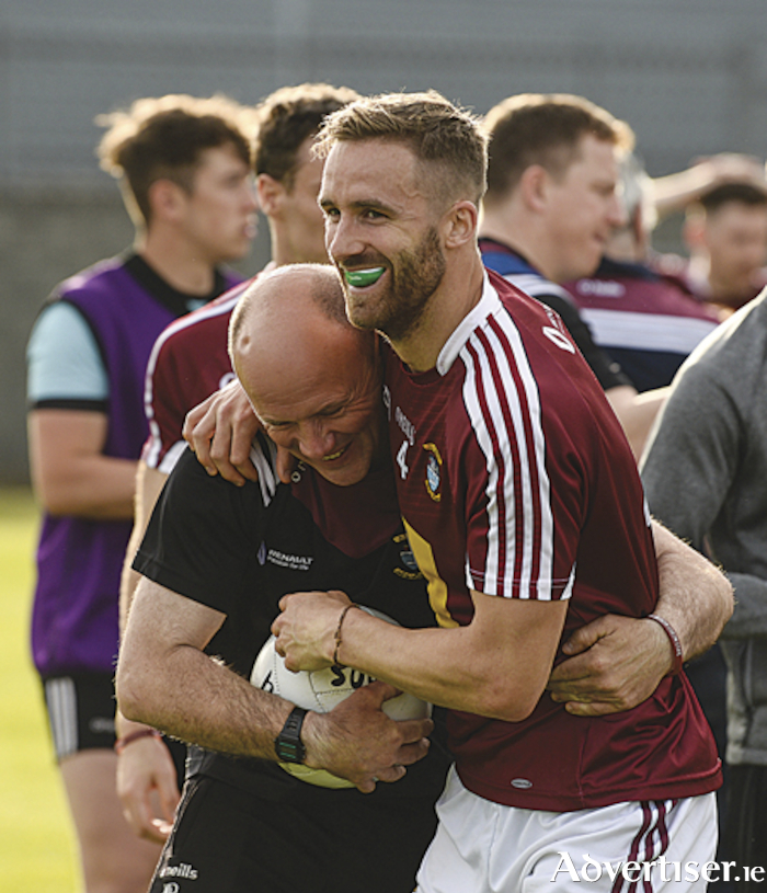 Caulry clubman, Kevin Maguire, in joyous mood with kitman, Mike Dillon, following Westmeath's six point win over Limerick in the All-Ireland qualifying series.  