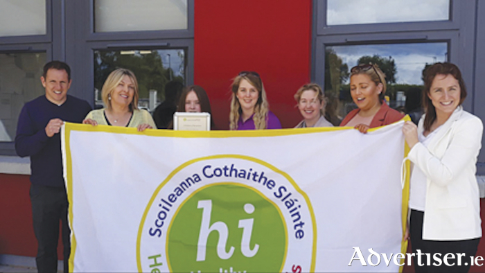 Coosan National School staff members  are pictured with the Healthy Ireland-Health Promoting Schools flag