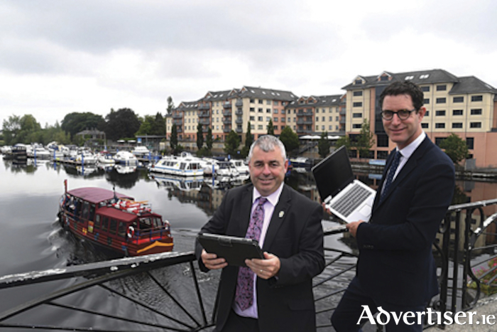 Minster of State, Kevin 'Boxer' Moran is pictured with Paddy Matthews, Head of Operations, Ireland's Hidden Heartlands, are pictured in Athlone following the announcement of Failte Ireland's website improvement programme aimed at boosting tourism within the region