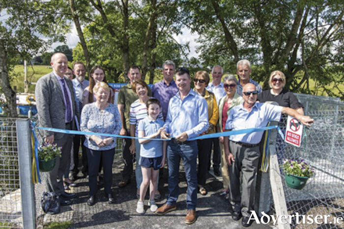 Tom Moran, Manager, ESB Fisheries, Patsy Beades, Chairperson of Lecarrow Tidy Towns and Suzanne Campion, Inland Fisheries Ireland, with members of the local community at the opening of the Lecarrow angling amenity.