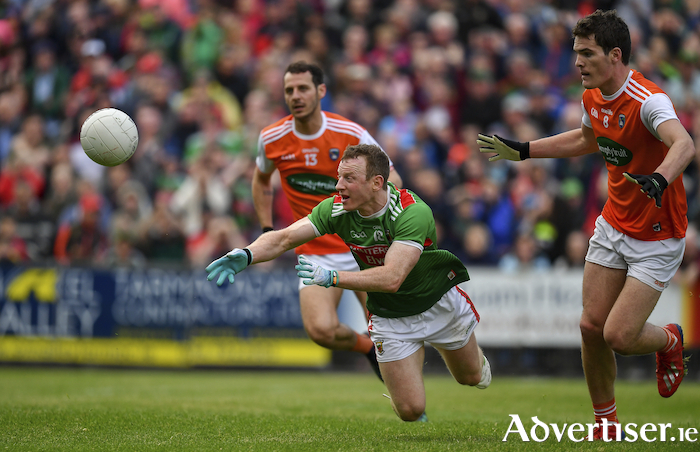 Ball and ball: Colm Boyle gets the ball away under pressure. Photo: Sportsfile