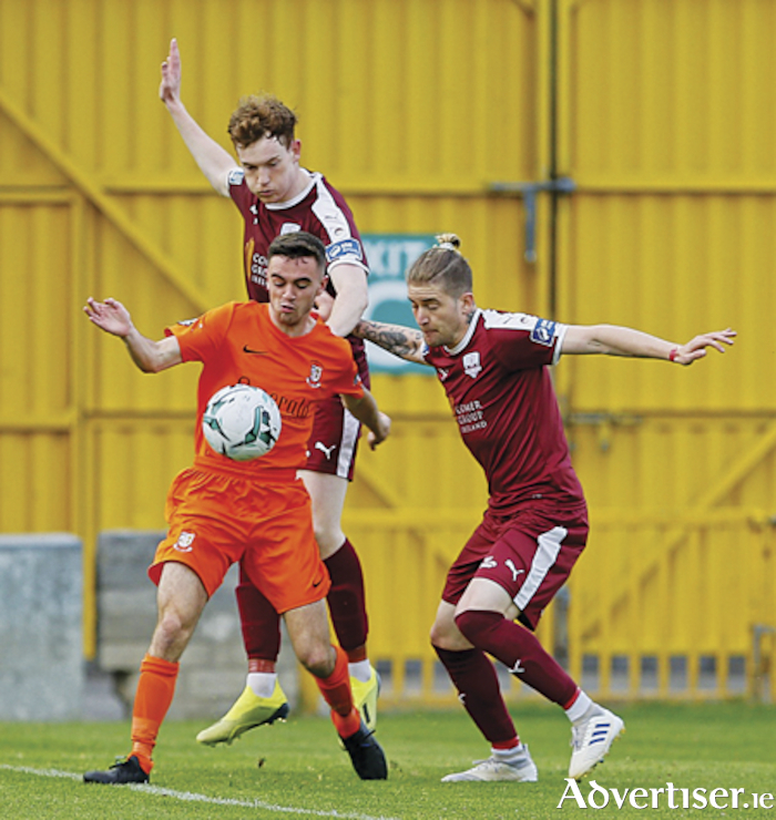 Athlone Town goal scorer Dean Williams holds off challenges from Galway's Ivan Gamarra and Jack Lynch.  Photograph by AC Sports Images.