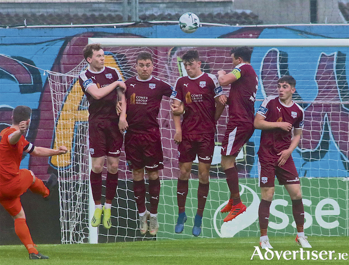 Galway United defensive wall of Conor Melody, Vinney Flaherty, Dara Costello, Marc Ludden and Cian Murphy prevent Athlone Town captain Kealan Dillon from scoring. Photo:-Mike Shaughnessy