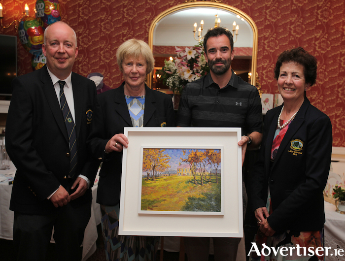 The winner of the Ballinrobe Golf Club's Presidents prize was Kevin Staunton he is pictured receiving a John Dinan oil painting from club president Mary Day. Also pictured are club captain Tony O'Toole and lady captain Eileen Conlisk. Photo: Trish Forde.