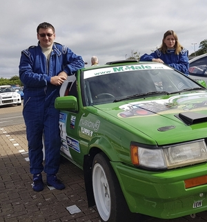 John Warren and his co-driver Ruthann O'Connor with their car