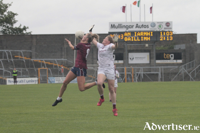 Westmeath's Johanna Maher claims possession from Galway's Mairead Coyne.