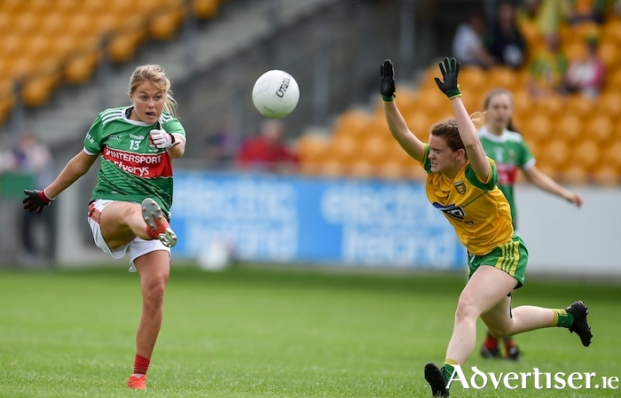 Up and over: Sarah Rowe kicks a score for Mayo. Photo: Sportsfile