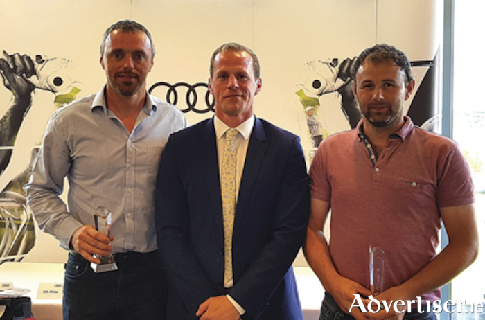 Winners of the Audi Athlone quattro Cup regional heat, Aidan Cowan and Kevin Walsh with Michael Moore Jnr (centre), dealer principal, Audi Athlone.