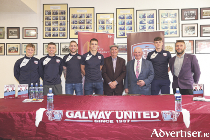 The Comer brothers Luke and Brian pictured with Galway United manager Alan Murphy and several of the club players.