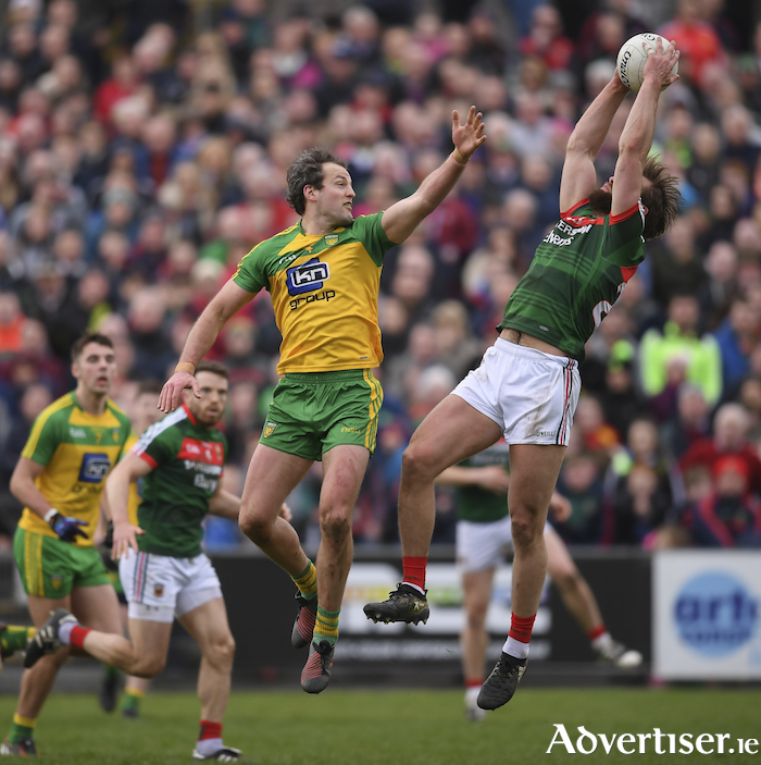 Up in the air: Aidan O'Shea wins the ball despite the attentions of Michael Muprhy in a previous meeting of the counties. Photo: Sportsfile