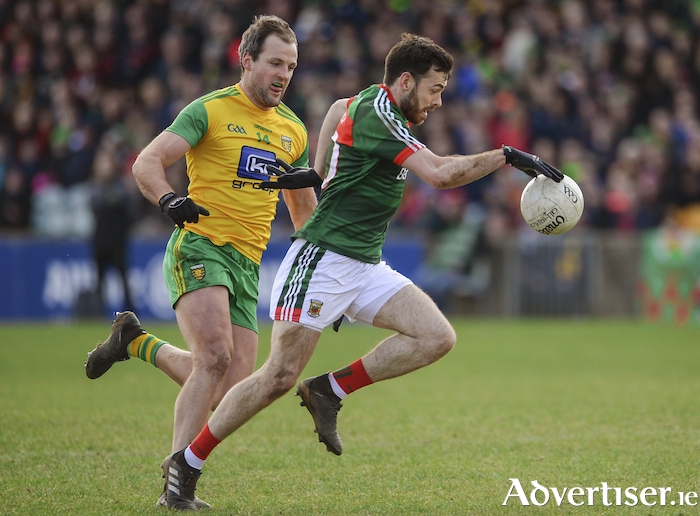 On the run: Kevin McLoughlin looks to escape Michael Murphy. Photo: Sportsfile