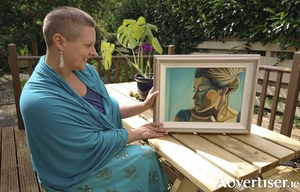 The artist Aine Doherty, with one of her paintings.