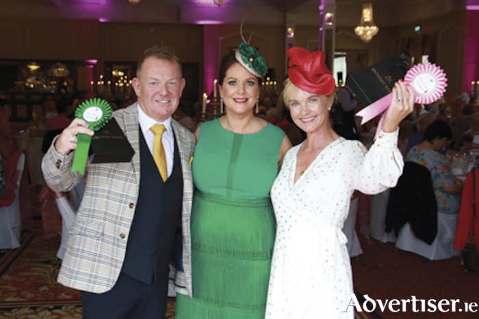 Cora Casserley of Anthony Ryans with best dressed winners Tom Burke of Loughrea and Adrienne Meagher of Ballyconneely at the First Furlong at The Ardilaun Hotel in support of National Breast Cancer Research Institute on Tuesday. Photo:-Mike Shaughnessy