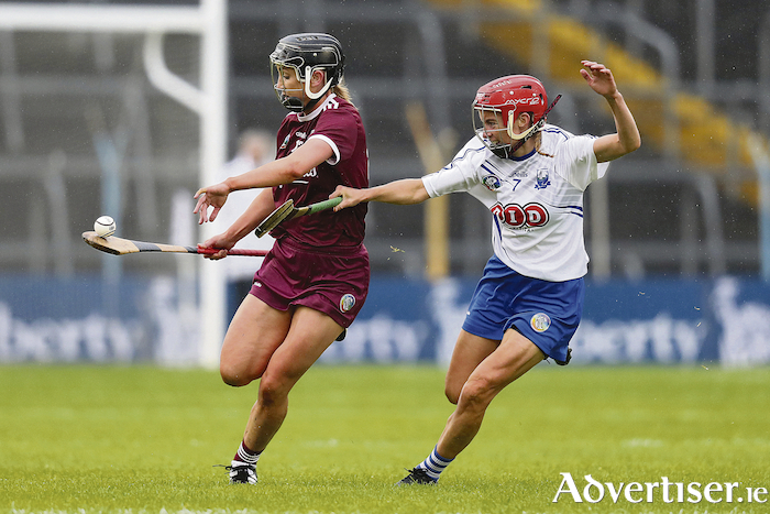 Galway's Niamh Kilkenny with Lorainne Bray of Waterford.   INPHO/Oisin Keniry