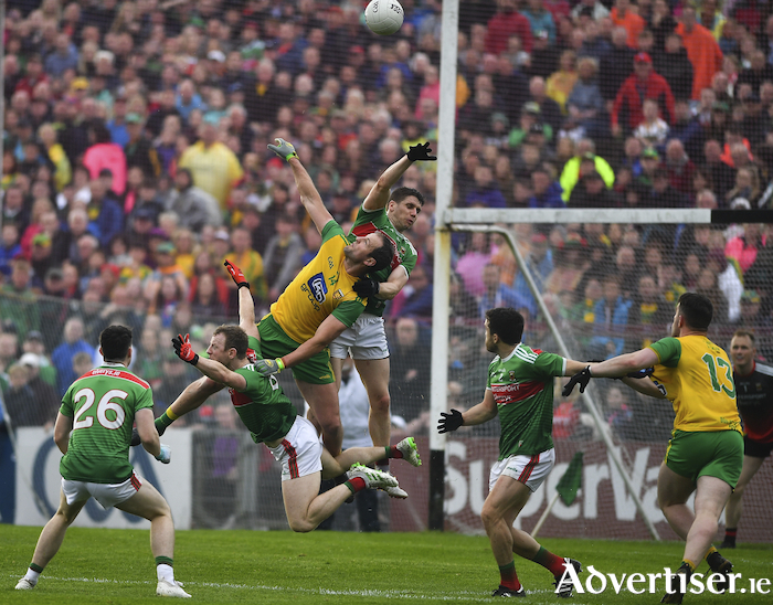 Up in the air: Lee Keegan and Colm Boyle engage in some aerial acrobatics with Michael Murphy last Saturday. Photo: Sportsfile