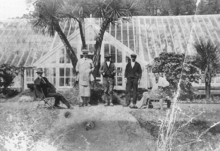 From left: Walter McCullagh (vutler), John McCormack (painter), Timothy Farrell (farm labourer), John Dyra (gardener), and 'Young' McCormack (painter) in the walled garden of Enniscoe House circa 1940.