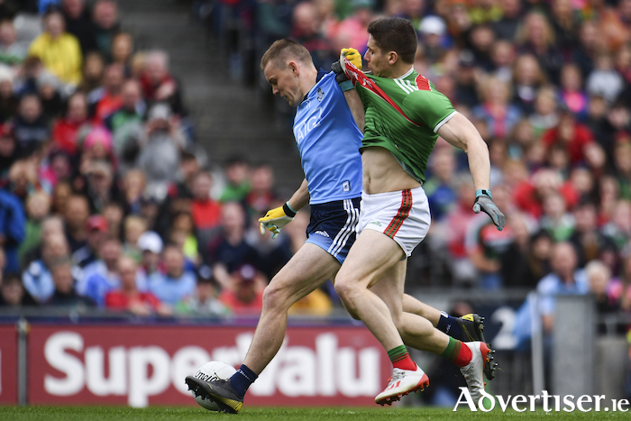 A fistful of Keegan: Con O'Callaghan and Lee Keegan battle for the ball last Saturday. Photo: Sportsfile