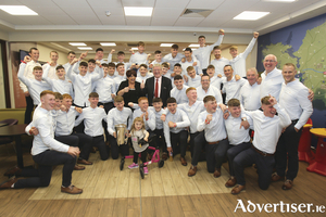 The cup that cheers: The Galway minor hurlers celebrate with sponsors Pat and Una McDonagh on their return from Croke Park with the Irish Press Cup.