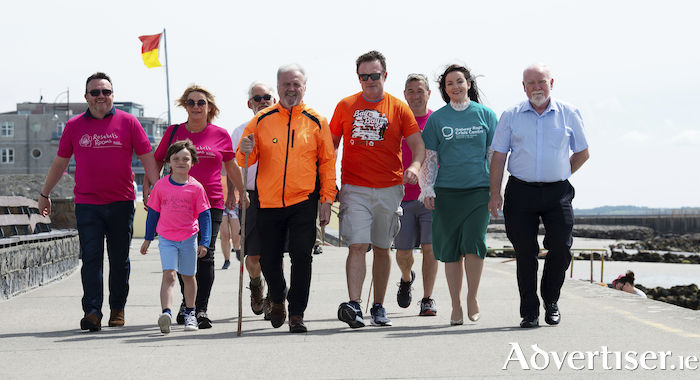 Gary and Suzanne Monroe and their son Ruben; David Lohan; Ronan Scully; Roy Gibson; Fergus McGinn; Joanne Tierney, Galway Rape Crisis Centre; and Cllr Donal Lyons ahead of Ronan's Scully's 350km charity walk. He will complete the walk on Saturday and is looking for volunteers to join him on the last 5ks.