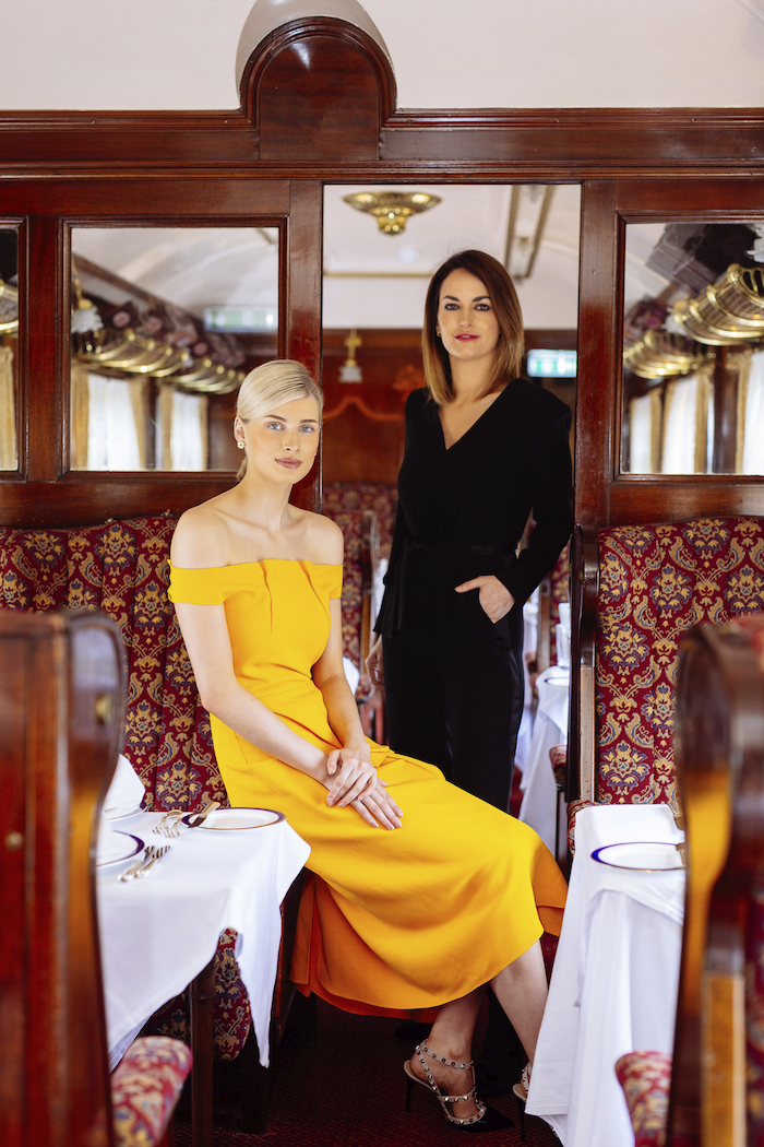 Brown Thomas Galway General Manager Marilyn Gallagher & model Katie Geoghegan launch the 'Brown Thomas Galway Charity Fashion Showcase' in the iconic Pullman Restaurant which comprises of two original carriages from the Orient Express in the grounds of Glenlo Abbey. The Fashion Luncheon takes place in aid of Croí, National Breast Cancer Research Institute & Rosabel's Rooms in the five star Glenlo Abbey on Sunday, 8th September.  Tickets are available from the three charities. IMAGE:  Julia Monard