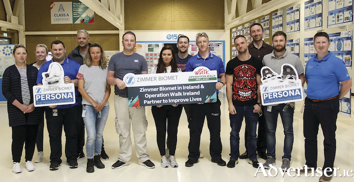 Some of the Zimmer Biomet team at Galway who manufactured the implants, used to transform the lives of 100 patients in Vietnam as part of Operation Walk Ireland. Pictured:Deimante KamarausKiene, Galway; Maria Moran, Mayo; Derek Nagle, Clare; Aaron Croke, Galway; Agnieszka Kurylo, Galway; Martin Lucas, Clare; Shanna Scully, Galway; Liam Walsh, Galway; Donal Dillon, Clare; Alan Zimny, Galway; Cormac O`Corcorain, Galway; Ruairi Cochrane, Antrim and Keith Barrett, Mayo.