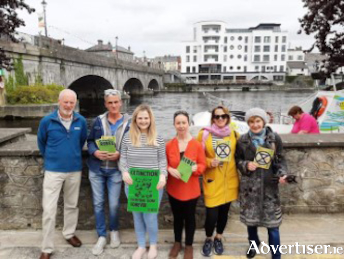 Local members of Extinction Rebellion are pictured along the banks of the River Shannon.  Left to right, Seán Butler, Anthony McGonigle, Aisling Connaughton, Julie O' Donoghue, Tara Keegan, Nora McGonigle.