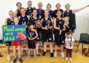 Joyous Mustangs after their victory in Drogheda Basketball Invitational last weekend:  Back row: Niamh O'Leary, Jenna Howe, Catriona White, Ellie White, Aedin Nic Flannchadha, Siobhan Kennedy. Front row: Ciara Griffin, Ciara Curran, Karen Mulherin (Captain), Siobhan Kilkenny, Sinead Hughes with top fans, Scout and Gracie-Bell Hussey and Realta and Faolan Loftus.