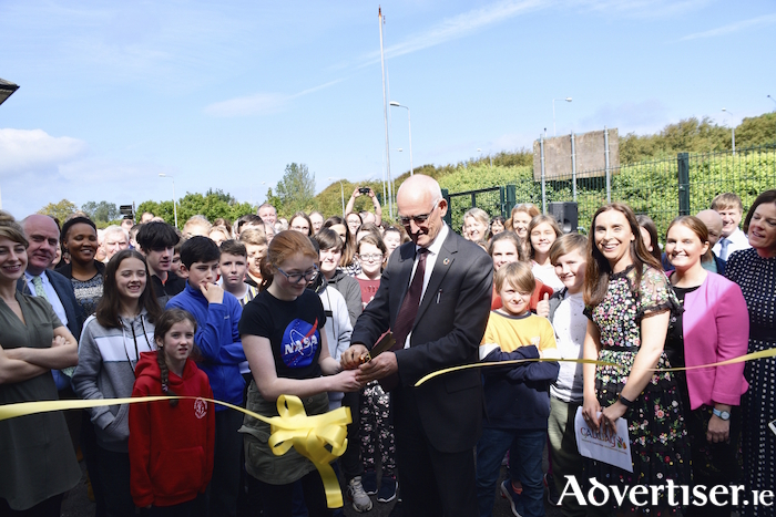 Paul Rowe, CEO of Educate Together cutting the ribbon to mark the official opening of the new Educate Together secondary school at its temporary accommodation at Grianach House beside Galway Crystal, Merlin Park.