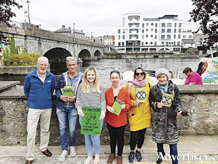 Local members of Extinction Rebellion are pictured along the banks of the River Shannon.  Left to right, Seán Butler, Anthony McGonigle, Aisling Connaughton, Julie O' Donoghue, Tara Keegan, Nora McGonigle.  The members are hosting a demonstration relating to climate change on Friday, September 20, the location for which is outside Athlone Library.