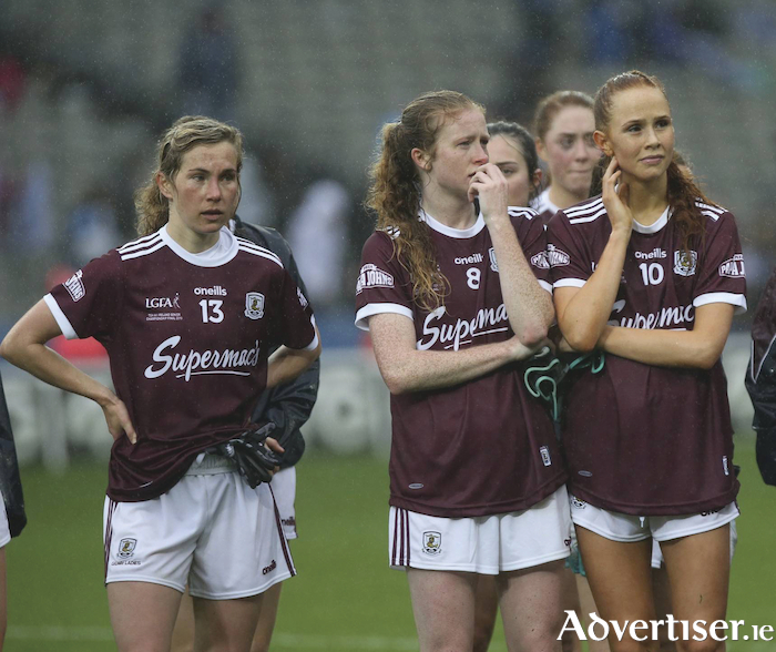 Galway's Tracey Leonard, Louise Ward and Olivia Divilly after their defeat to Dublin in the TG4 All Ireland Ladies Football Senior Championship final in Croke Park on Sunday. 					Photo: Mike Shaughnessy