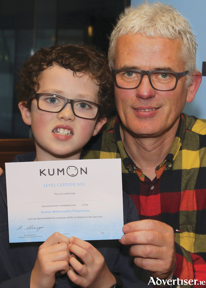 George Curley with his dad John at the recent Kumon awards ceremony. Photo: Mike Shaughnessy.