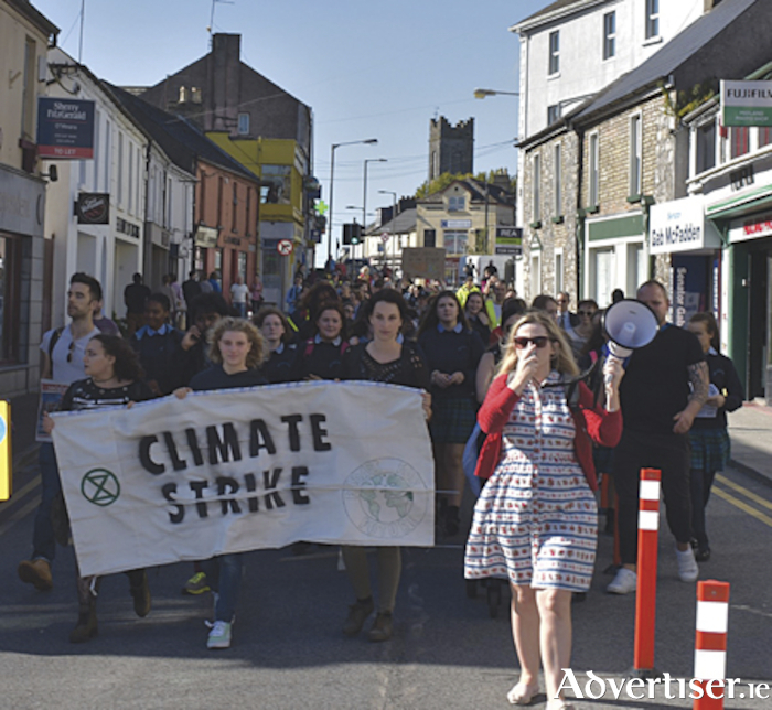 Local secondary school students and members of Extinction Rebellion Athlone take part in a global climate demonstration through the streets of the town on Friday last.