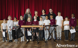 Hugh Kelly, director of Maoin Ceoil na Gaillimhe; Anna Lardi-Fogarty from Music for Galway; Aislinn Ó hEocha, director of Babóro; and Terry Cooke, percussionist,  with pupils from Scoil Chroí Íosa, Newcastle, who are taking part in the 'Carnival of the Animals' education outreach programme developed by Hugh Kelly of Adventures in Music and Maoin Ceoil na Gaillimhe in association with Baboró and Music for Galway. Photo:- Anita Murphy