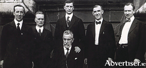 On top of the Waldorf-Astoria during de Valera's first press conference after his arrival in New York June 24 1919, are left: Harry Boland, honorary secretary Sinn Féin, Liam Mellows, Eamon de Valera, Diarmuid Lynch, secretary of Friends of Irish Freedom, and Dr Patrick McCartan, Irish envoy to Washington. Seated is John Devoy of Clan na Gael. (Note Dev's hand on Devoy's shoulder)