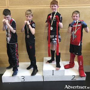 Cillian Honan and Darren O Shea from Limerick (joint bronze);  Finn Foley of Galway Black Dragon, gold winner  U12; and Patrick Sherlock of Ennis, silver medalist).