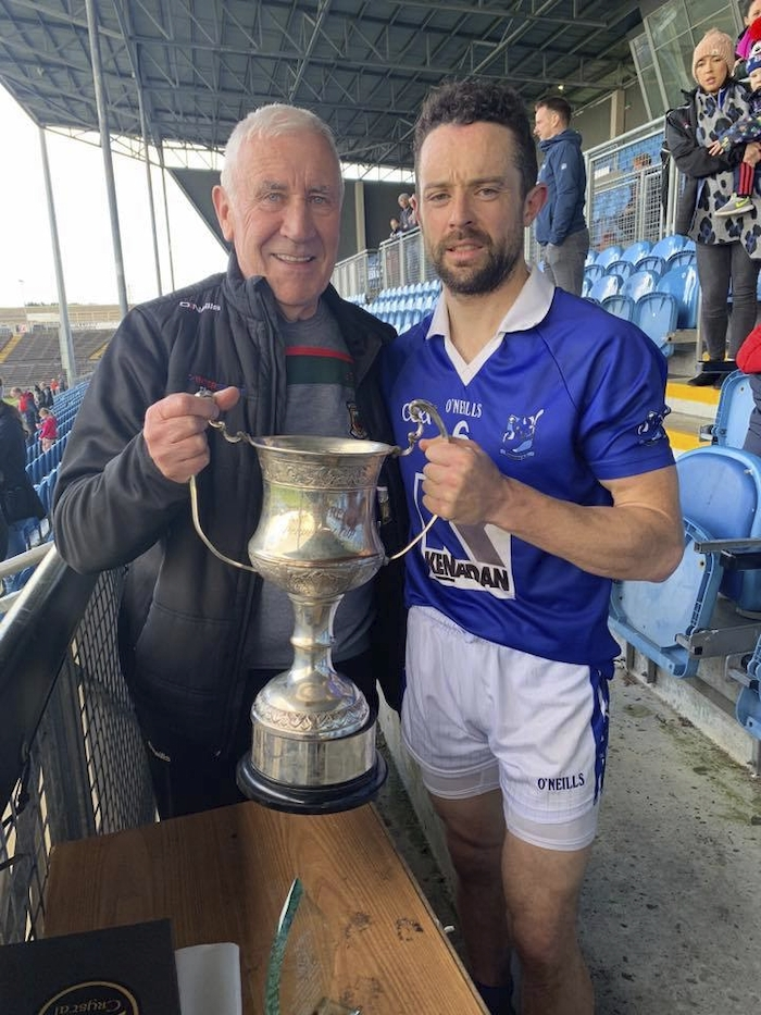 Tooreen captain Stephen Coyne is presented with the TJ Tyrell Cup. Photo: Mayo GAA