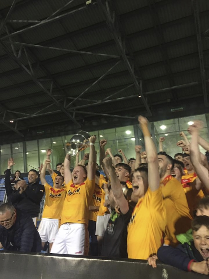 Cup of Joy: Castlebar Mitchels captain Eamon Tiernan lifts the cup after his sides four point win over Kilmaine. Photo: MayoGAA